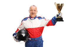 Senior car racing champion holding a trophy. Studio shot of a senior car racing champion holding a trophy isolated on white background royalty free stock photos