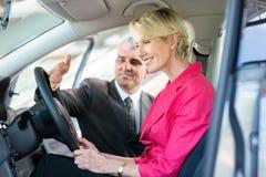 Senior car sales consultant customer Stock Image