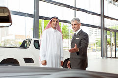 Senior car salesman arabic man Royalty Free Stock Image