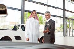 Senior car salesman arabic man Royalty Free Stock Image
