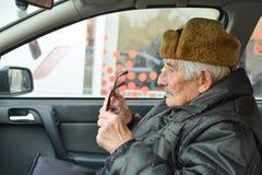 Senior in a car Stock Photos