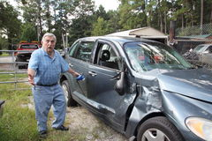 Senior car wreck. Senior man upset his car is wrecked Stock Images