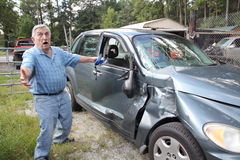 Senior car wreck. Senior man upset his car is wrecked Royalty Free Stock Photos