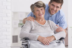 Senior care assistant with disabled woman Royalty Free Stock Photos