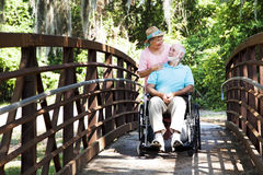 Senior Caretaker on Bridge Stock Photography