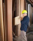 Senior Carpenter Arranging Planks Stock Photo