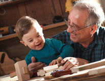 Senior carpenter and his grandson Royalty Free Stock Image