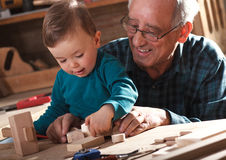 Senior carpenter and his grandson Royalty Free Stock Photos