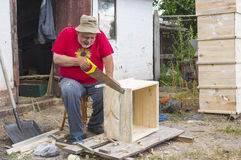 Senior carpenter making beehive Stock Photo