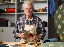 Senior carpenter Stock Image