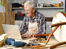 Senior carpenter Stock Photography