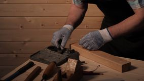 Senior carpenter preparing to work. Senior carpenter working in his workshop stock video footage