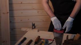Senior carpenter sawing board stock video