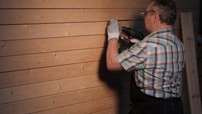 Senior carpenter tighten the. Senior carpenter working in his workshop stock video footage