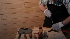 Senior carpenter tighten the screw stock video footage