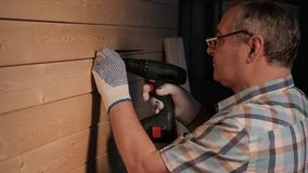 Senior carpenter tighten the. Senior carpenter working in his workshop stock video