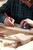 Senior carpenter working in hi workshop Stock Photography