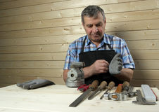 Senior carpenter working in his workshop Stock Image