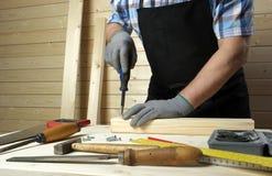 Senior carpenter working in his workshop Royalty Free Stock Image