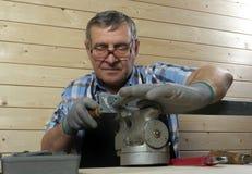 Senior carpenter working in his workshop Stock Photos