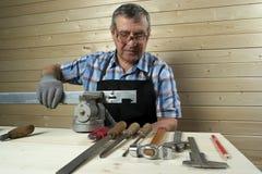 Senior carpenter working in his workshop Royalty Free Stock Images