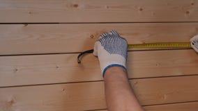 Senior carpenter working with ruler. Senior carpenter working in his workshop stock footage
