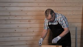Senior carpenter working with ruler. Senior carpenter working in his workshop stock video footage