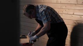 Senior carpenter working with straightedge. Senior carpenter working in his workshop stock video