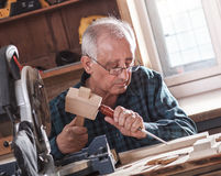 Senior carpenter working with tools. Royalty Free Stock Photography