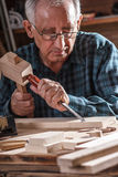 Senior carpenter working with tools. Royalty Free Stock Image