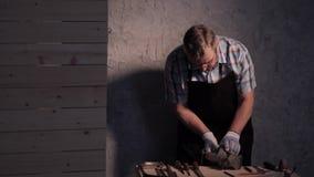 Senior carpenter working with vise. Senior carpenter working in his workshop stock video