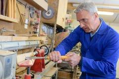 Senior carpenter working at workshop stock photography