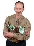 Senior with cash. Slick and alternative sardonically grinning senior business man loaded with Euro banknotes. Isolated over white Royalty Free Stock Photography