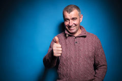 Senior casual man shows thumb up Royalty Free Stock Image
