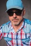 Senior casual man wearing baseball hat and sunglasses Royalty Free Stock Photo