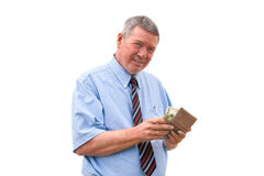 Senior Caucasian businessman payin Royalty Free Stock Images