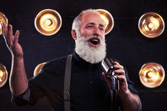 Senior Caucasian male singer giving a live soul singing performa Stock Photo