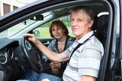 Senior Caucasian male and woman sitting in land vehicle Stock Photography
