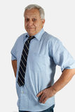 Senior caucasian man. Portrait of senior caucasian man with grey hair wearing shirt and tie with arms on waist royalty free stock images