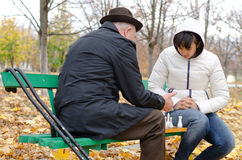 Senior Caucasian man spending quality time playing chess with his young granddaughter Stock Images