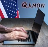 Senior caucasian man types about Q Anon deep state conspiracy. Senior caucasian man types on computer. Concept background illustration for QAnon or Q Anon, a stock photos