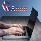 Senior caucasian man types about Q Anon deep state conspiracy. Senior caucasian man types on computer. Concept background illustration for QAnon or Q Anon, a stock image