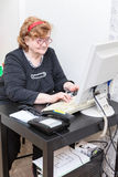 Senior Caucasian woman working in office room Royalty Free Stock Photography
