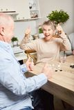 Senior celebrating victory in board game match Stock Photography