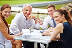 Senior CEO doing planning with business team Royalty Free Stock Image