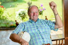Senior chair watching football match in the tv Stock Photos