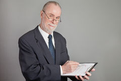 Senior with a checklist Stock Photo