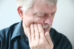 Man suffers from face pain Stock Images