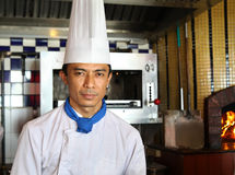 Senior chef. Portrait of senior chef in the kitchen Stock Images