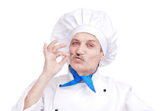Senior chef making gourmet gesture Royalty Free Stock Image